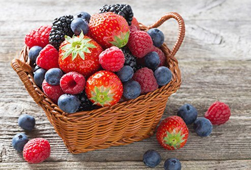 A basket full of mixed berries, good for fighting depression.