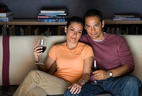 A couple having a late night glass of wine.