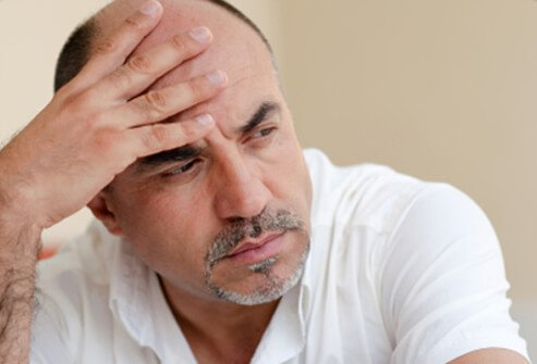 A man considers different hair loss treatments.