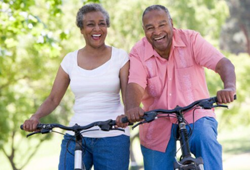 Senior couple enjoys a bike ride.