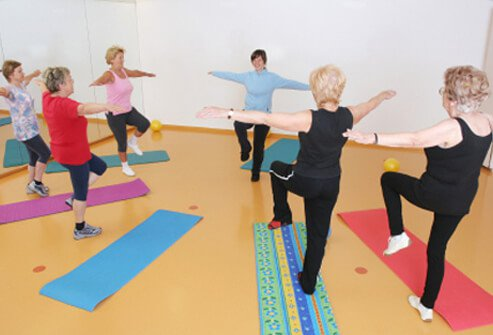 Senior women taking a balance exercise class.