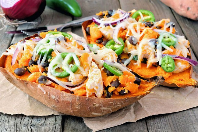 Shredded rotisseries chicken makes a good addition to sweet potatoes.