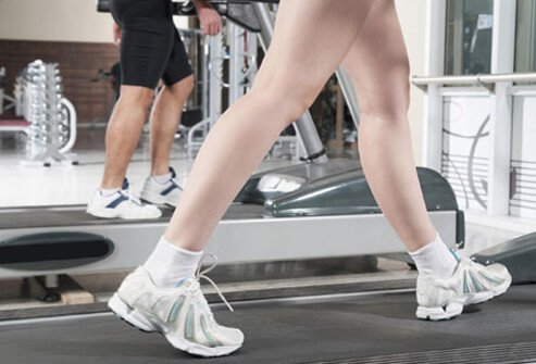 Walking on treadmill, trying to prevent heart disease.