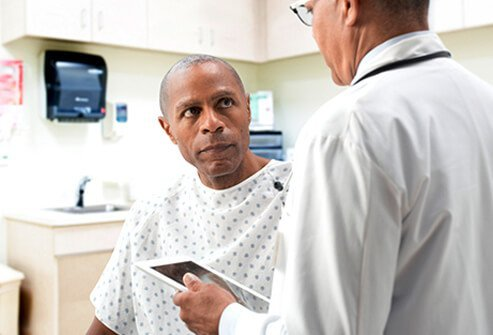 A doctor discusses hemorrhoid diagnosis with a patient.