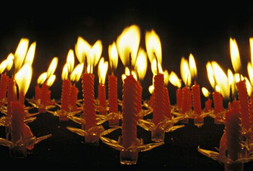 Photo of burning candles on cake, symbolizing pulmonary hypertension.
