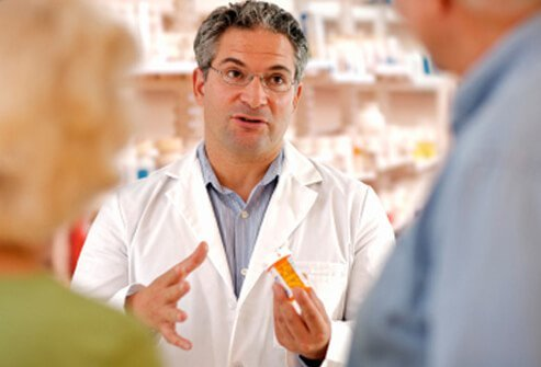 A pharmacist discussing medications with a couple.