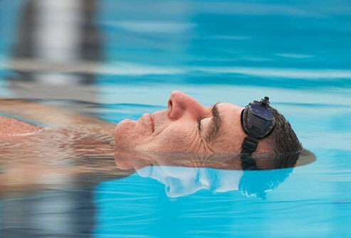 A man floats in a pool.