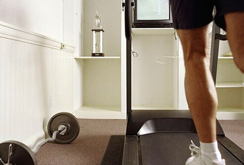 A man works out at home.