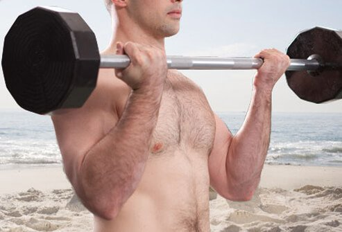 Photo of man doing barbell curl.