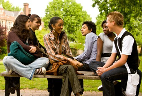 A group of students socialize and hang out.