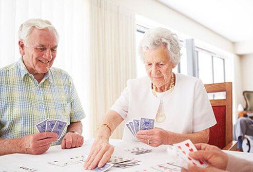 A group of seniors playing cards.