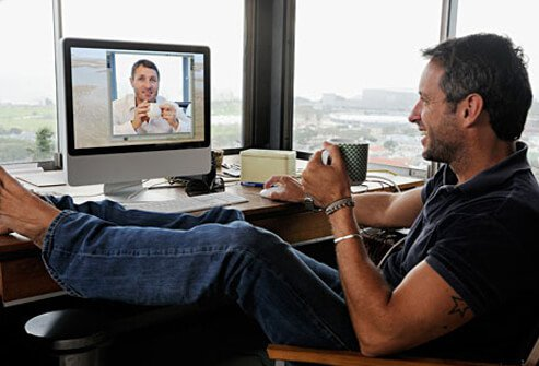 Photo of two men in video conference call.