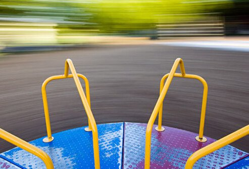 Photo of merry go round spinning rapidly.