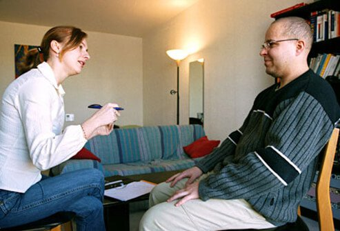 Photo of man listening to female counselor.