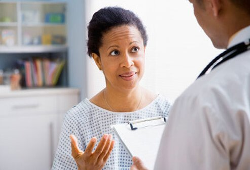A female patient speaking with her doctor.