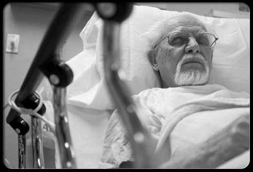 A patient rests in a hospital bed after pancreatic cancer radiation therapy.