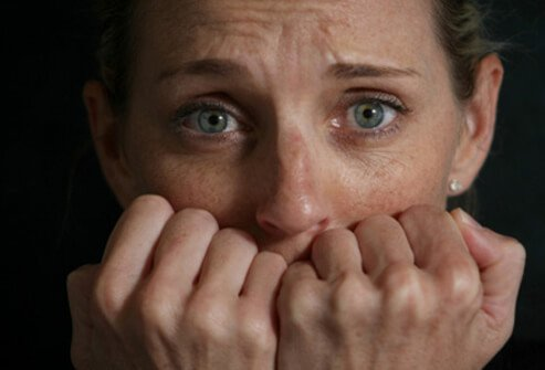 A woman is stressed and having a panic attack over her phobia.