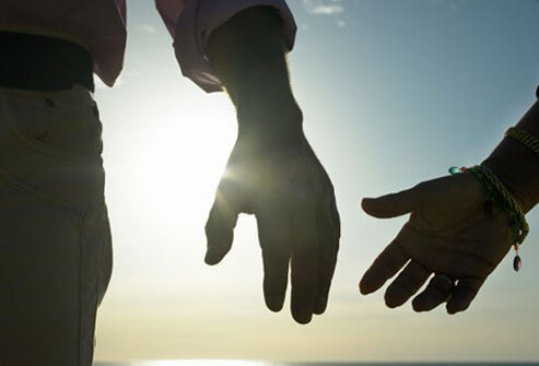 Photo of a couple holding hands.
