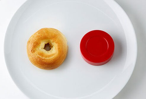 For a single 1-ounce serving of grains, that's about half a medium bagel, the size of a hockey puck.