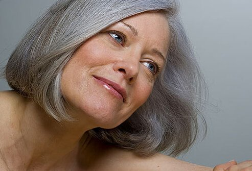 Photo of mature woman smiling.