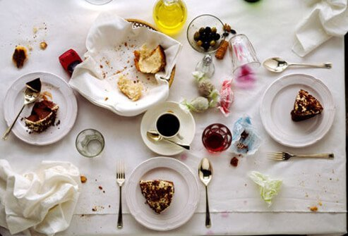 A messy table after dinner, resulting in poor sleep.