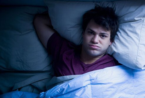 A man with insomnia, having trouble sleeping.
