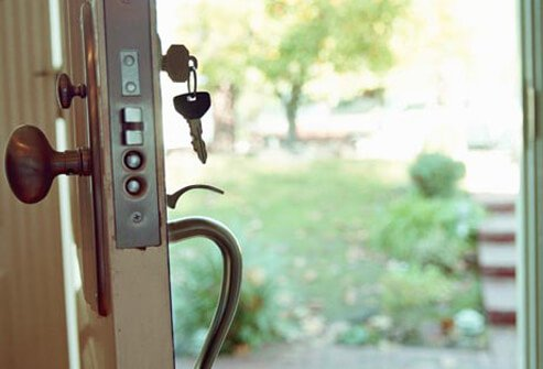 Photo of keys in door.