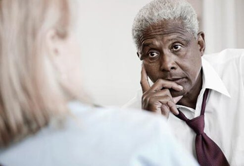 Photo of a man talking to a doctor.