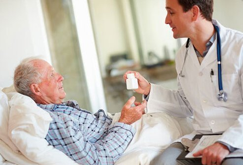 A doctor gives antibiotics to a patient with a Staph infection.