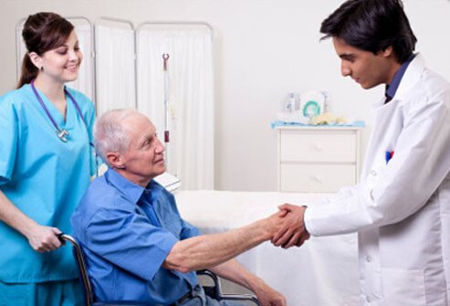 A doctor and nurse greet a new patient.