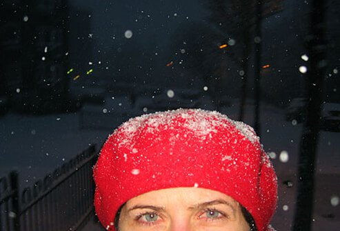 Photo of woman in a winter snowstorm
