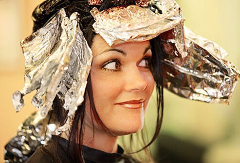 Photo of woman having hair dyed.