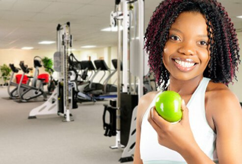 Benefits Of Exercise Easy Weight Loss Tips A Woman Enjoys A Healthy Snack At The Gym