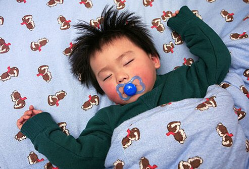 Photo of baby sleeping with pacifier.