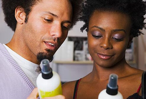 Photo of couple looking at hair product labels.