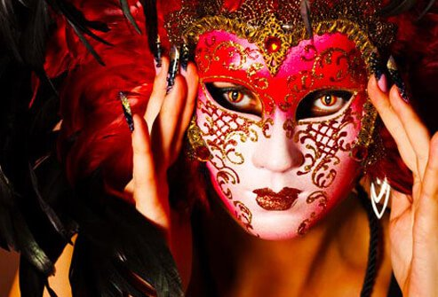 Photo of woman wearing Venetian mask.
