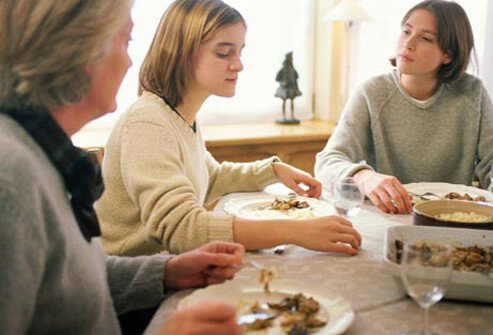 A family eats dinner and talks about anorexia.