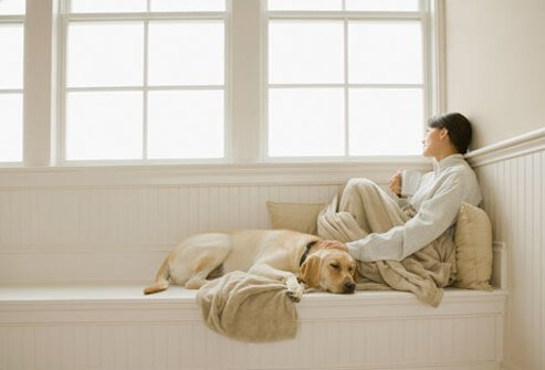 Photo of woman with lupus sitting with dog.