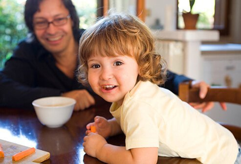 A young child happy about being a vegetarian.